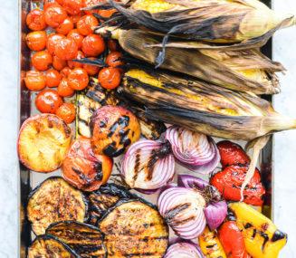 an assortment of grilled veggies on a metal sheet pan