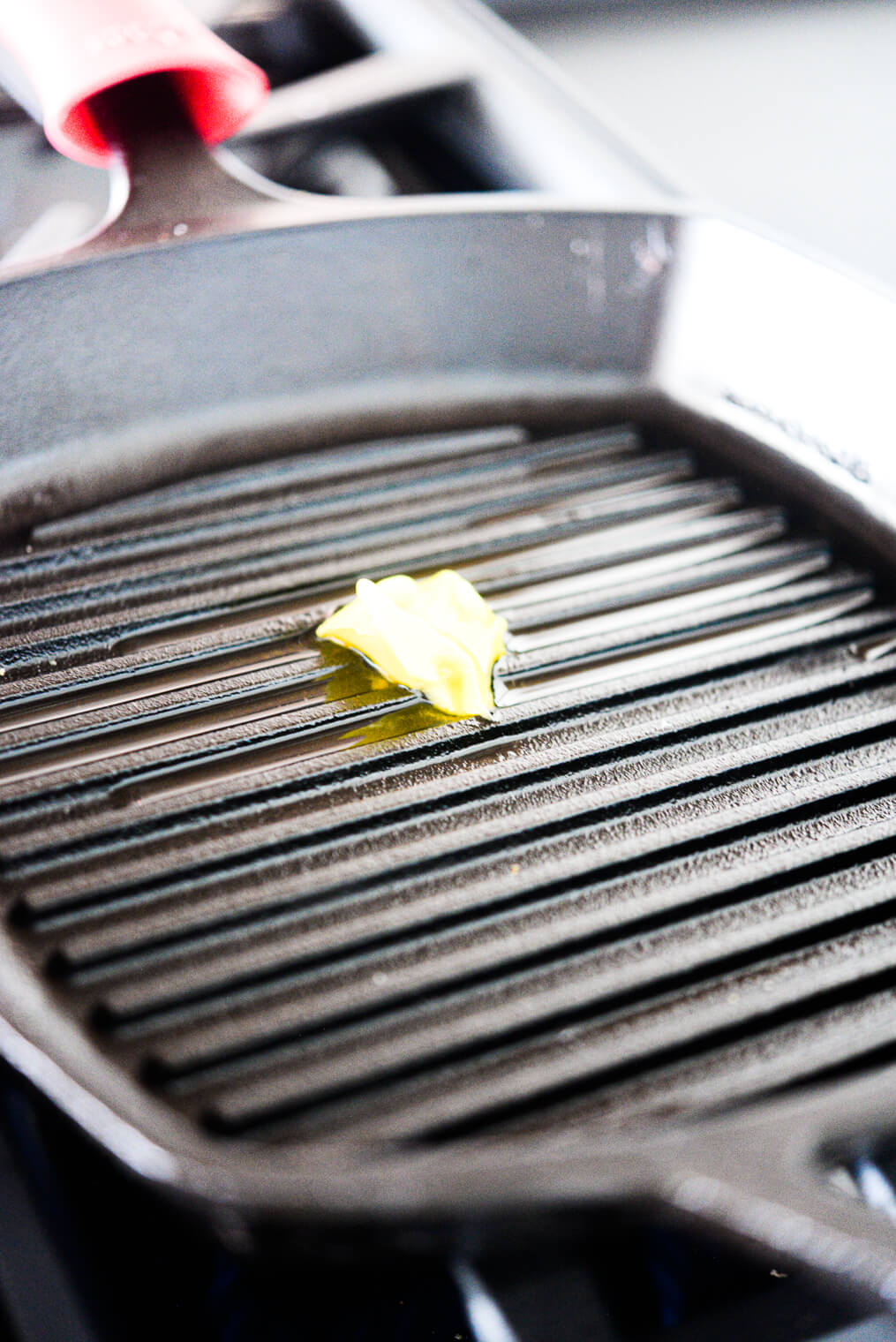 a grill pan skillet with butter in it starting to melt