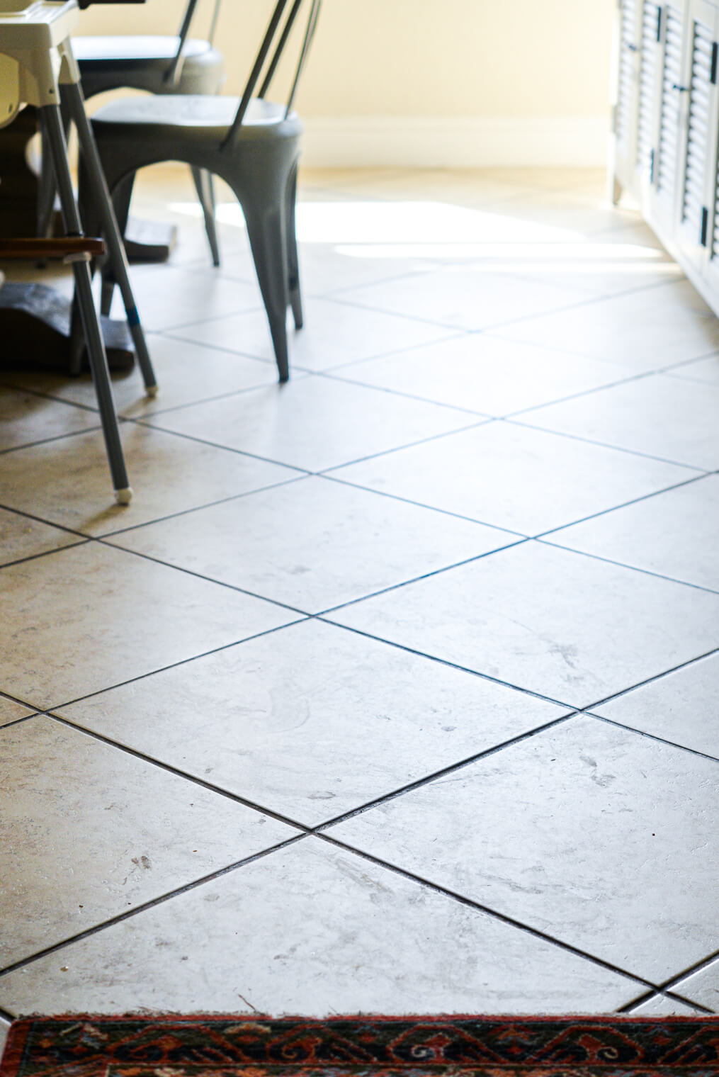 a dirty tile floor before being mopped