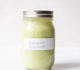 a labeled jar of avocado dressing