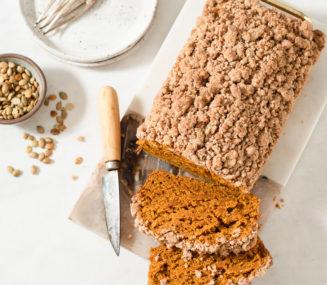 a loaf of sliced vegan pumpkin bread