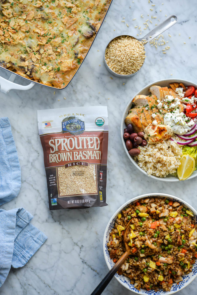 three chicken dishes (creamy chicken rice casserole, Greek power bowls, and chicken fried rice) surrounding a bag of Lundberg's sprouted brown basmati rice