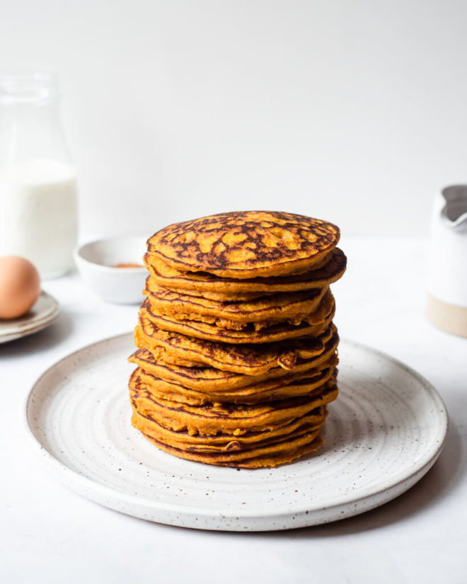 a stack of pumpkin pancakes on a plate