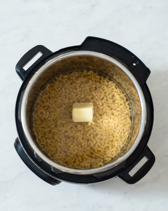 macaroni noodles, water, and butter in an instant pot