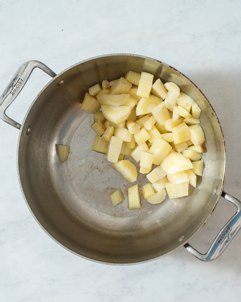 chopped parsnips in a stainless pot