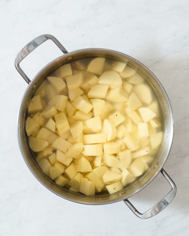 a large stainless pot of chopped potatoes to boil