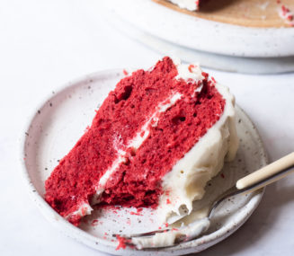 a piece of red velvet cake on a small plate