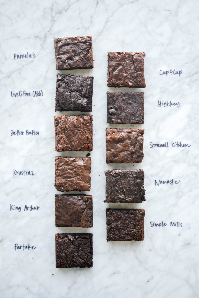 11 different boxed brownies on a marble surface, all clearly labeled